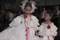 Show me how you can turn big sister. Youngest of the carnival girls. Las Tablas, Panama.