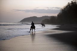 Ride into sunset, Pacific Beach, Cambutal, Panama.,