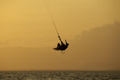 Under an bloody red sky. Kite surfer in air, Punta Chame, Panama.