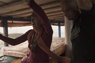 Christina, feeling sick, on a rough ocean, leaving Miramar, Panama for Colombia on a commercial boat.
