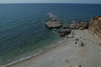 Greece, pebbles beach, blue sea till horizon.