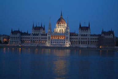 Budapest lit parliament at night, Danube in front.