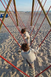 Boys on swing.