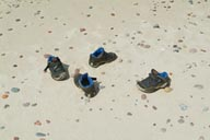 Childrens shoes abandoned on beach.