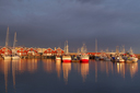 Norway, Bodo, red ships in midnight sun light.
