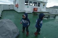 Twins on ferry boat ride Norway.
