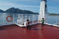 Boys on late ferry ship, Fjord, Norway.