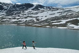 Boys on snow on a lake, Strynefjellet.