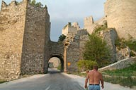 Bare chested man, infront of Golubac Fortress, Serbia, Danube.