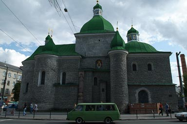 Green Cupola on orthodox church in Ternopil, Green old van in front. Ukraine.