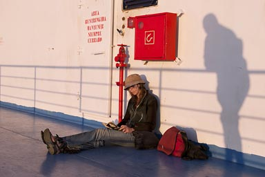 C. reading book on Baja ferry, Shadow is watching.