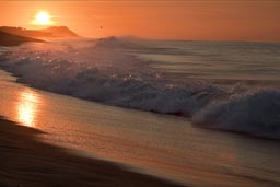 Reflection of sunrise light in wave spume, Baja California Sur.