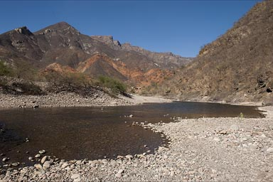 Red and warm colors of Urique Canyon and River.
