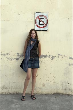 C. and short skirt, San Blas, Nayarit. No-parking sign.