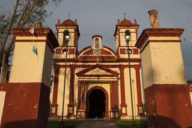 Little red and yellow country church, Samahil, Yucatan, evening light.