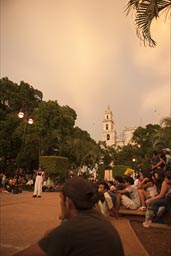 Merida, Yucatan, People gather on main Cathedral Square at dusk.