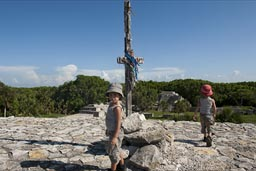 The cross and the boys on top of Maya X'cambo pyramid, Yucatan.
