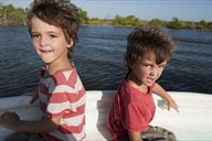 Boys visibly tired from watching birds all morning on a boat trip on Rio Lagartos, Yucatan, Mexico.