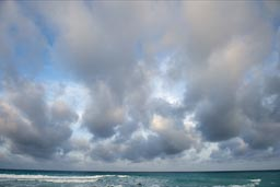 Turquois water, Cancun coast. Evening clouds.