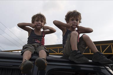 My boys on top of van are reluctant to come down.