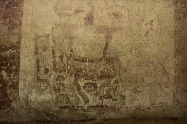 Painted Maya mural in XelHa. Figure wearing bracelet.