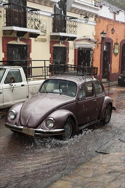 Vochito in heavy rain in calle in San Cristobal de las Casas, Chiapas.