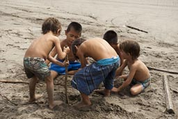 Boys make friendship quickly. Pacific Beach. Playa Bonfil near Acapulco.