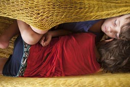 Asleep in a hammock. Boys sleep in Zipolite.