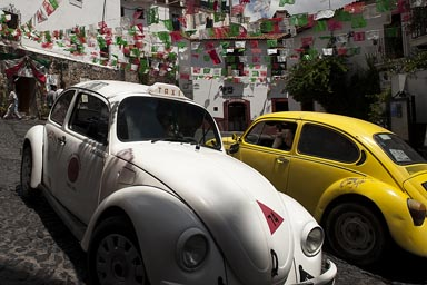 Yellow and white Vochito. Volkswagen beetles in Taxco, Mexico.