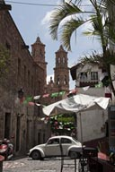 Volkswgen, beetle, street cafe, church in back. Taxco.