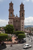Taxco, main square, Vochito. Santa Prisca Church.
