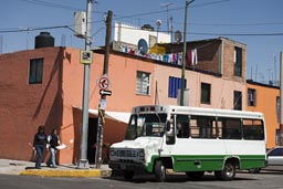 Bus and orange house, Mexico City.
