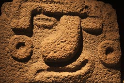 Wryly smile in stone, museum, Teotihuacan.