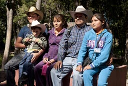 Mexican family posing for picture.