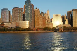 Sun is reflecting in office buidings, and Hudson River, Downtown Manhatten, NY.