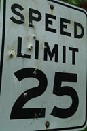 Speed limit sign, bullet pierced.