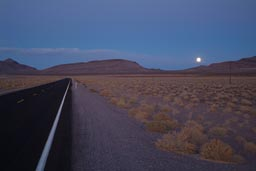 Full moon over road to Nevada.