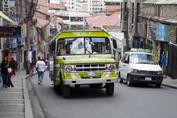 Green Dodge bus in Calle Santa Cruz, central La Paz, Bolivia.