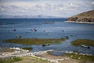 Boats, fish farming, reed on Lake Titicaca, Peru.