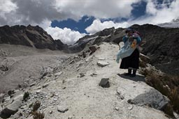 An idigenous woman on her way up to the refuge on 5,250m. Huayna Petosi, Bolivia.