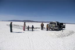Family working on the salt flats of Coipasa, to break salt.
