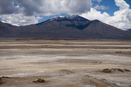 Is muddy after the rains, crossing will not be easy, where? Bolivia altiplano volcano and plains.
