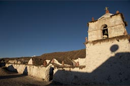 Late sun and a bit of shade, deep bleu sky on Parinacota white church, up on 4,600m, Northern Chile,