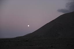 The full moon behind Morro Moreno, near Antofagasta, Chile.