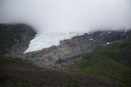 Glaciers and clouds hang deep.