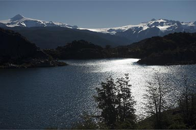 Small Los Patos Lake far in back against late sun, South Patagonian Ice field.