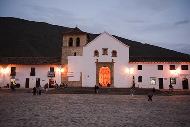Peak inside the church of Villa de Leyva, on golden altar, Colombia.