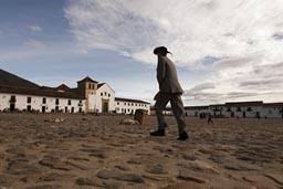 Man and hat on main square of Villa de Leyva, Colombia.