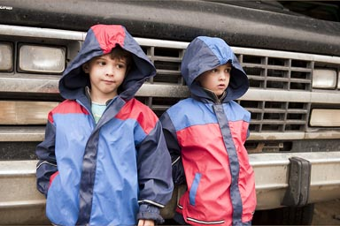 Boys and rain jackets in front of van, Popayan, Colombia.