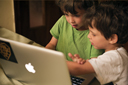Twin boys, Daniel and David, 5, learning computer.